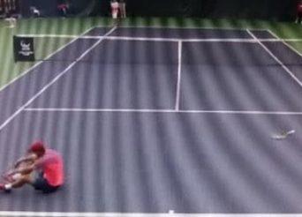 Tennisspelaren lägger sig - matchfixning bild